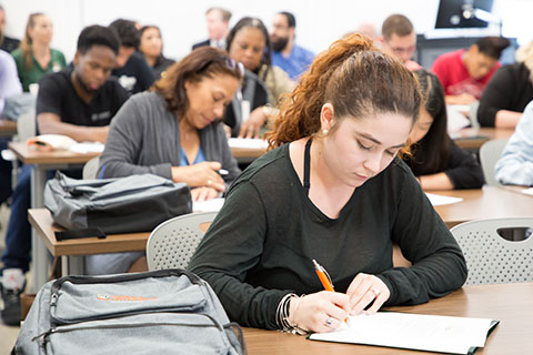 A photo of a student in a classroom at the University of Miami.